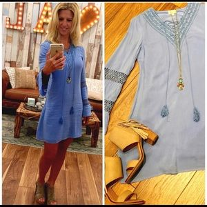 Classic Tunic with bell sleeves.
